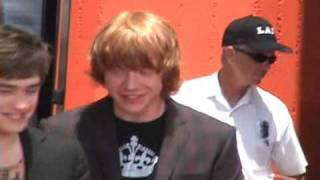 Rupert Grint, Emma Watson, Daniel Radcliffe talking at the Hand/Wand/Foot Ceremony