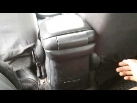 Где в Suzuki Grand Vitara колодки ручника