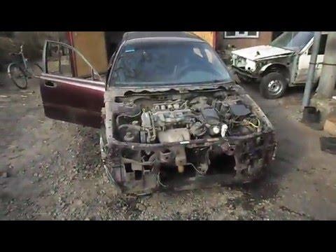 Где у Mazda Capella находится выпускной коллектор