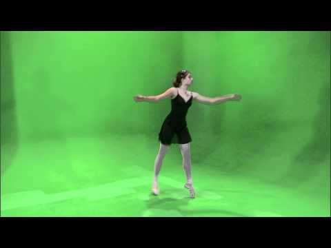Ballerina dancing en pointe on a green screen.