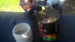 getlinkyoutube.com-HOW I MIX HEALTHY PIGEONS BLEND POWDER INTO MY PIGEONS FEED.