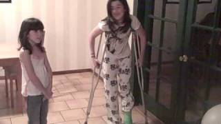 Green long leg cast and crutches