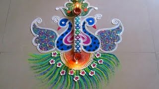 getlinkyoutube.com-Beautiful and unique twin peacock rangoli   Innovative rangoli designs by Poonam Borkar