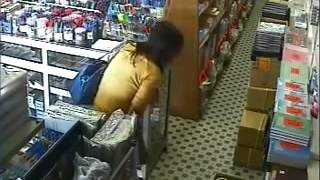getlinkyoutube.com-A pretty female shoplifter stealling MASSIVE amount of items get caught