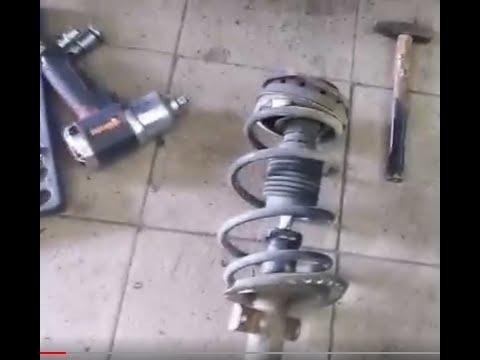 Рено меган 2.Как заменить амортизатор передний Рено меган 2
