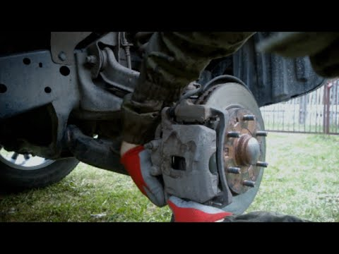 Обслуживание передних тормозов на Pajero Sport II.