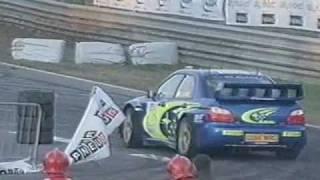 getlinkyoutube.com-Valentino Rossi  Subaru Impreza Vs Colin Mcrae - Monza Rally Show 2005