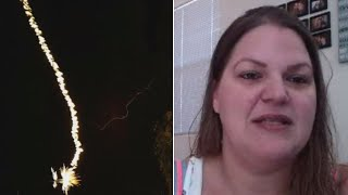 Lightning Bolt Strikes Just Feet Away From Woman Shooting Video of Storm