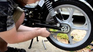 getlinkyoutube.com-How to change rear sprocket on a Tomos moped.