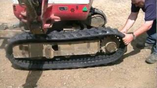 getlinkyoutube.com-Takeuchi TB016 Fitting New Rubber Tracks HD