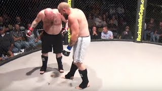 getlinkyoutube.com-Fighter craps all over cage mat during fight!