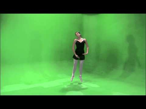 Clip of a ballerina dancing en pointe on a green screen.