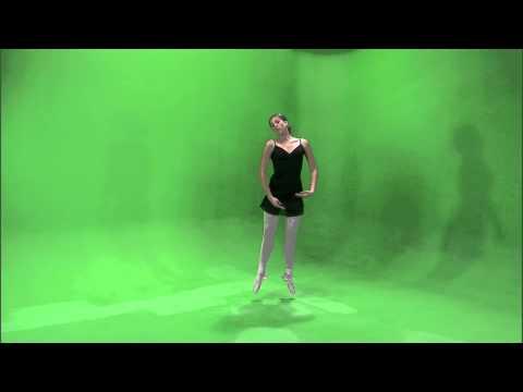 Clip of a ballerina dancing en pointe on a green screen.