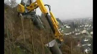 getlinkyoutube.com-Menzi Muck A91 sideways on a hillside working in a vineyard