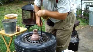 getlinkyoutube.com-pottery throwing demo on a car tire~by Hillar Bergman