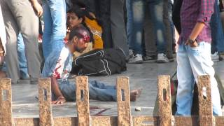 half murder of a thief by victim on ara railway station,bihar,india on 15th may 2014