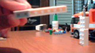 getlinkyoutube.com-how to make a relly simple lego gun that shoots