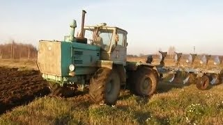 T-150K ploughing with reversible five furrow plow
