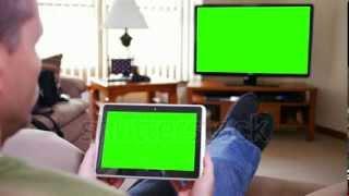 getlinkyoutube.com-Man with iPad Watches TV Green Screen Stock Footage