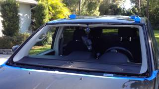 How to install windshield on a 2012 Chrysler Town and Country with the Rolladeck