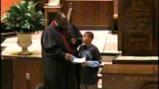 Pastor Brooks giving a certificate of biptisamal