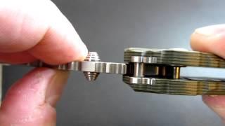 getlinkyoutube.com-How Does a Button Lock on a Knife Work?