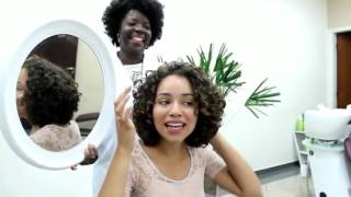 Women haircut on long hair to a curly bob cut width=