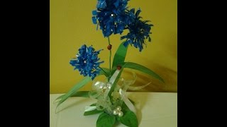 getlinkyoutube.com-Best Out Of Waste Plastic transformed to Cute Curly Blue flower Showpiece