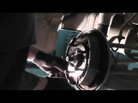 Расположение в Mazda 3 колодок ручника