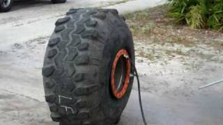 "getlinkyoutube.com-mounting 44 swamper mud tire on 21"" wide rim v1"