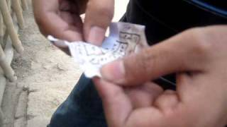 getlinkyoutube.com-Trip to graveyard: Destroying black magic spells, taweez (amulets, talisman) in Pakistan