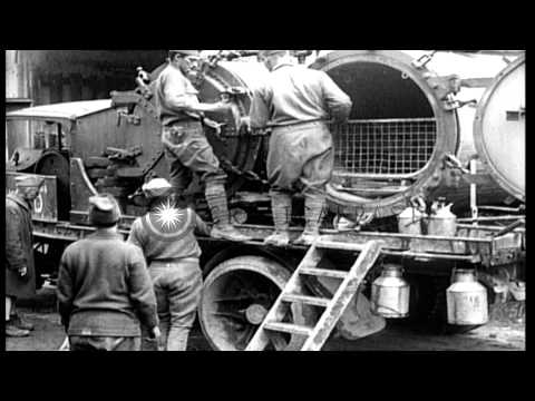 US troops having their clothing deloused by steam, during World War I HD Stock Footage