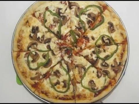 """كيف تصنع """"بيتزا"""" مثل المطاعم ?"""