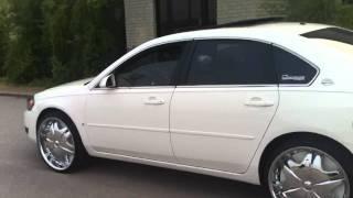 white 06 impala on 22s