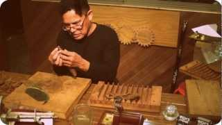 getlinkyoutube.com-Cuban master shows how to roll a cigar Old World style (pre-industrial revolution)