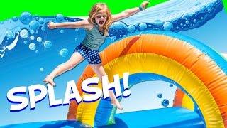 getlinkyoutube.com-Assistant Slip N Slide Bounce House Carnival Challenge Surprise Toys Video