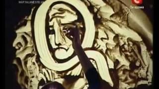 getlinkyoutube.com-Amazing Sand Art on Ukraine's Got talent - Kseniya Simonova