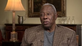 Hank Aaron on breaking barriers at bat.