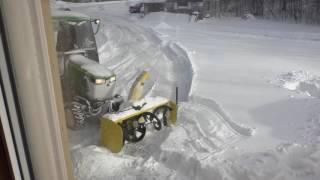 John Deere 1025R blowing snow