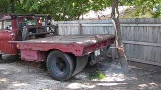 PULLING TREE OUT OF THE GROUND WITH A 1955 WINCH TRUCK