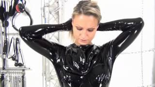 getlinkyoutube.com-Girl puts on a latex / rubber condom catsuit