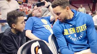 Steph with kid (courtesy: Warriors)