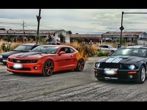 """Chevrolet Camaro Ss Vs Ford Mustang Shelby Cobra 2007"" MP3 Gratis"