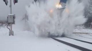 getlinkyoutube.com-Norfolk Southern And Amtrak Train Snow Blasts Boy At Crossing