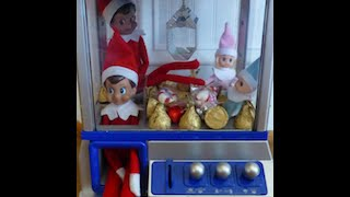 My Elf on the Shelf Caught inside The Candy Claw Machine....