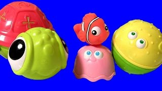 getlinkyoutube.com-Disney Finding Nemo Stacking Cups Surprise Eggs! Disney Frozen Toys 2 Chupa Chups Masha Bear Fashems