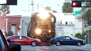 Street Runner Traffic Ignores Train In Downtown City