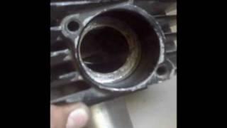 getlinkyoutube.com-Suzuki ax100 , limpieza de cilindro , piston y culata