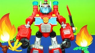 getlinkyoutube.com-Playskool Heroes Electronic Transformers Rescue Bots Heatwave the Fire Bot robot saves fire
