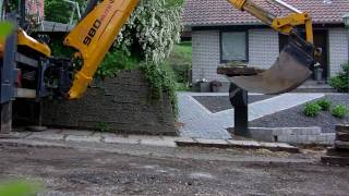 getlinkyoutube.com-Backhoe removes pavement